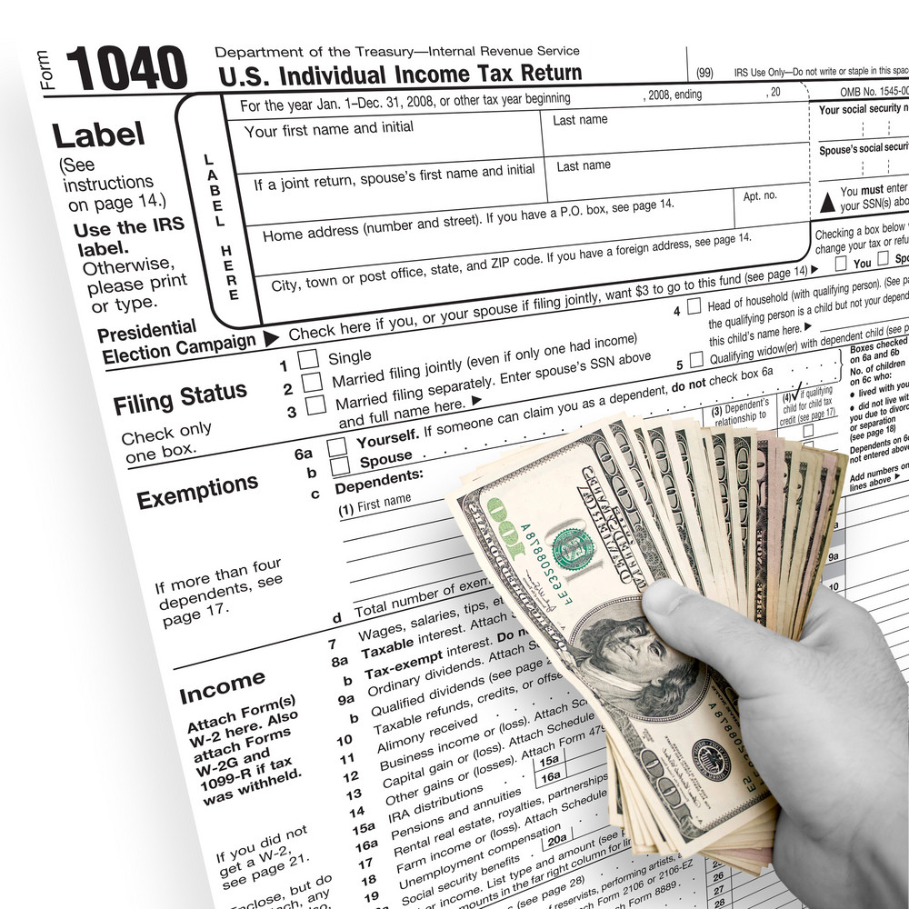 A tax time themed montage for US taxpayers with a hand full of money fanned out.