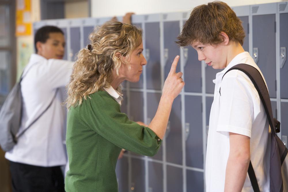A teacher telling a student off
