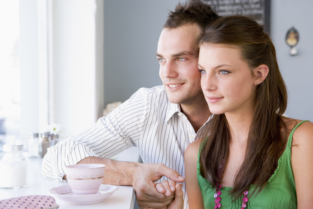 A young couple drinking tea in a cafe