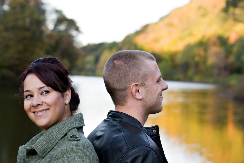 A young happy couple outdoors on a fall day.