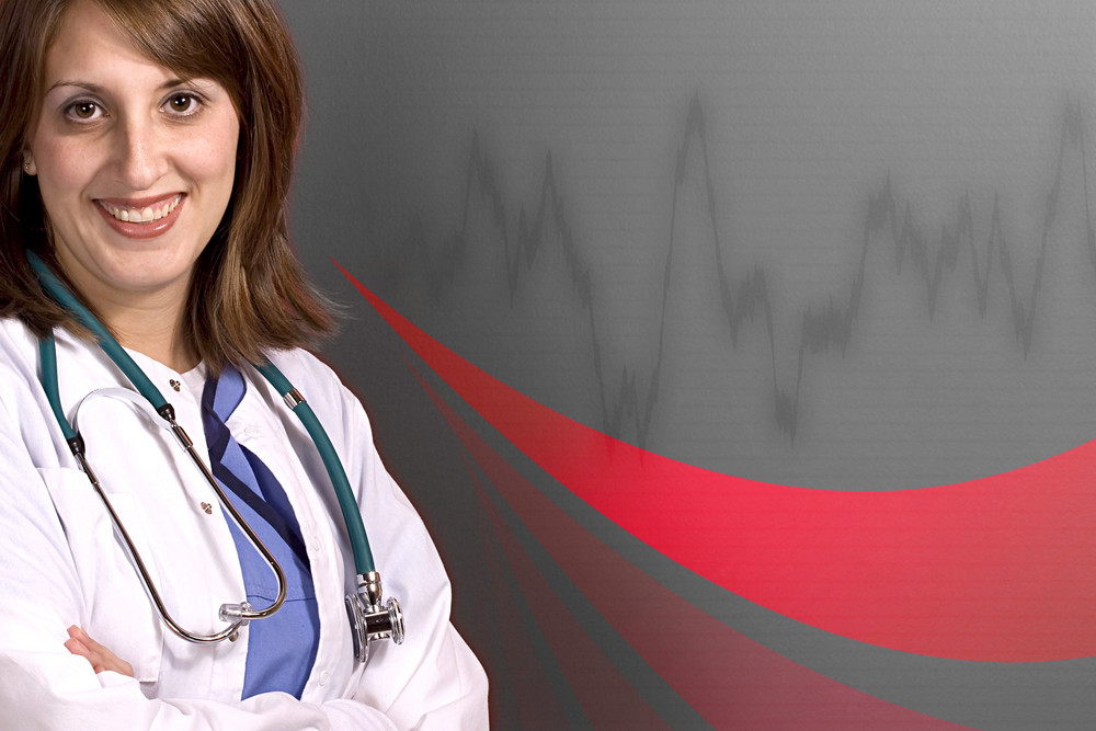 A young medical professional isolated over a cardiogram background with copyspace.