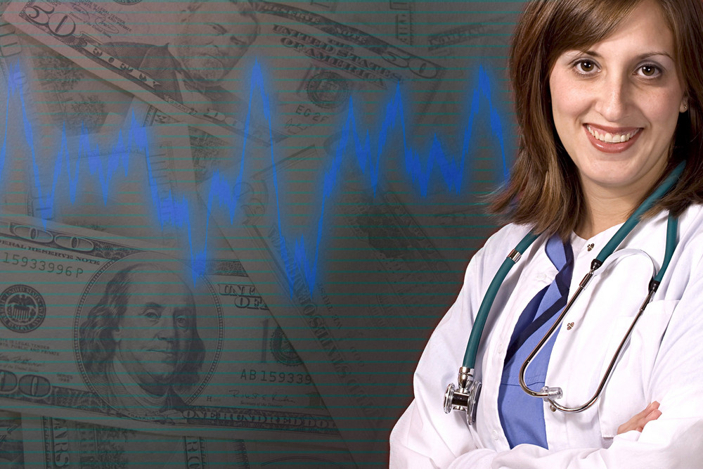 A young medical professional isolated over a money background with copyspace.