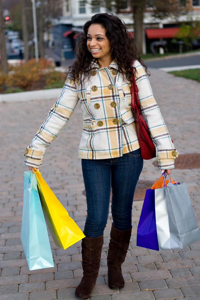 A young shopaholic out shopping in the city.