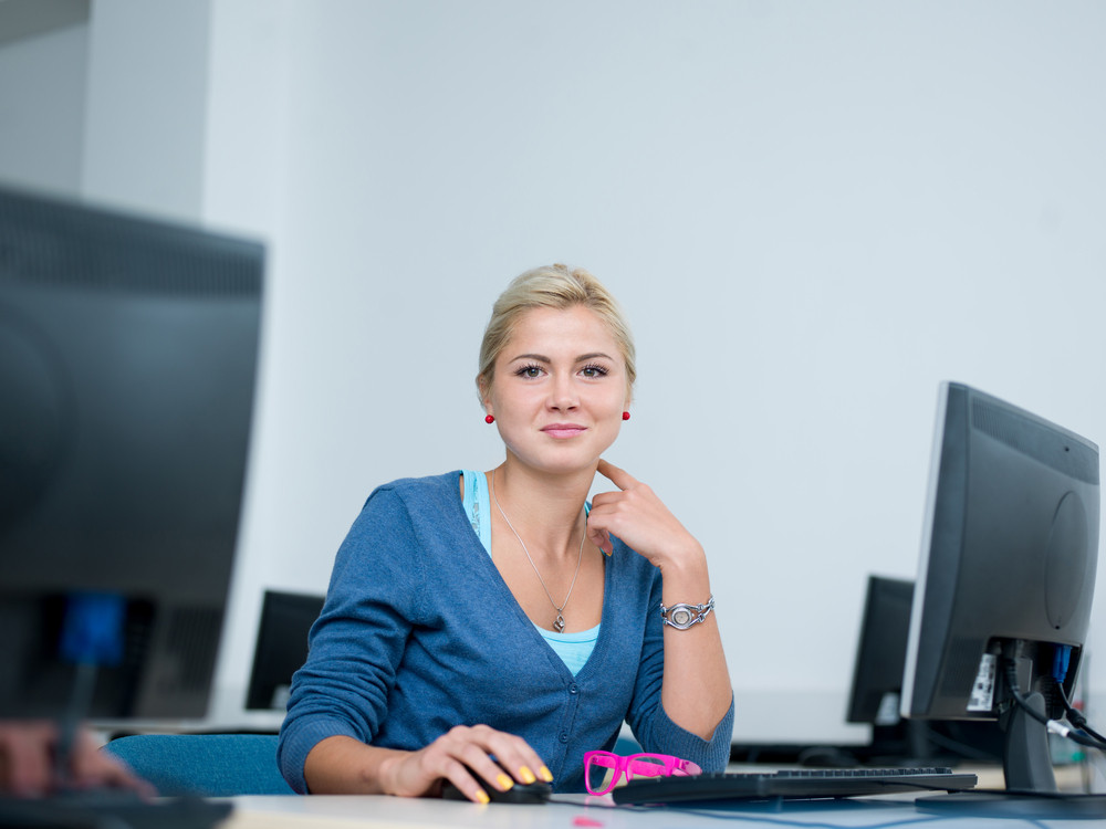 Student woman in computer lab classroom