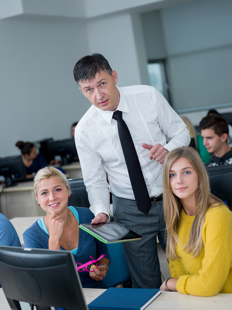 Group of students with teacher in computer lab