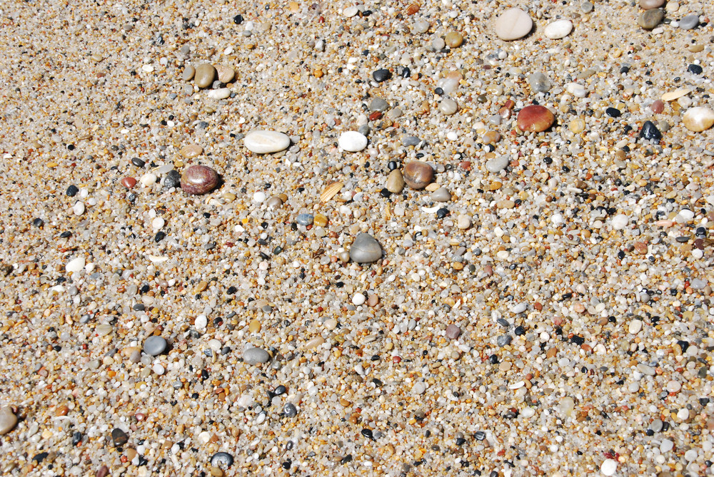 Abstract Background With Colorful Stones At The Beach