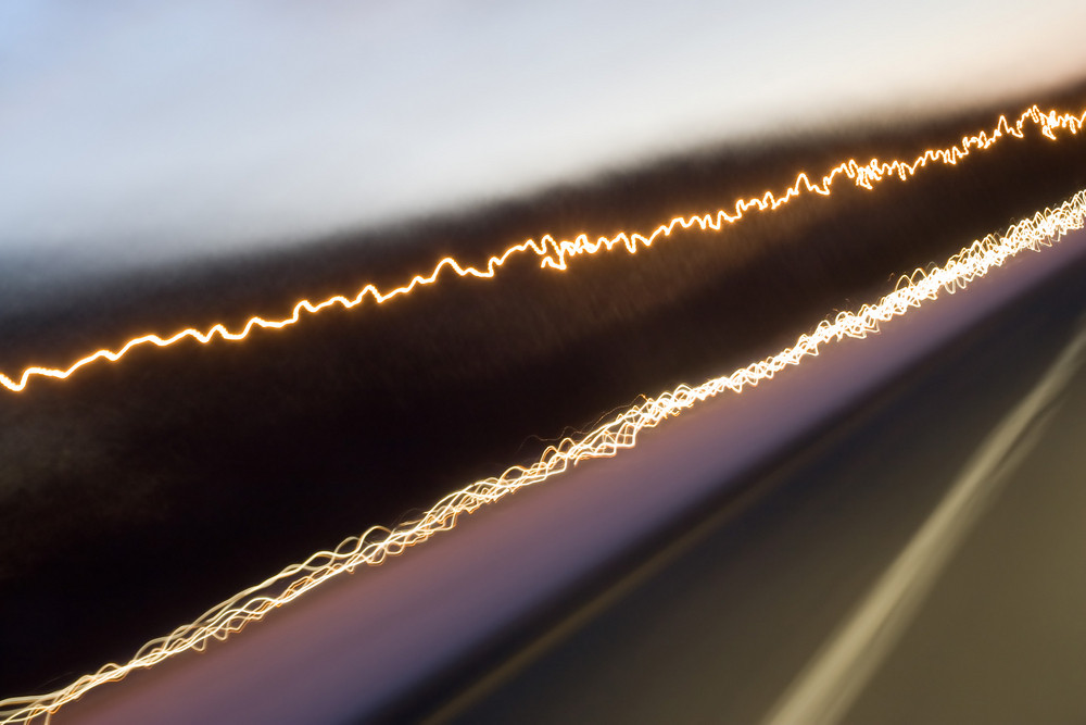 Abstract light trails captured from cars signs and other landmarks.