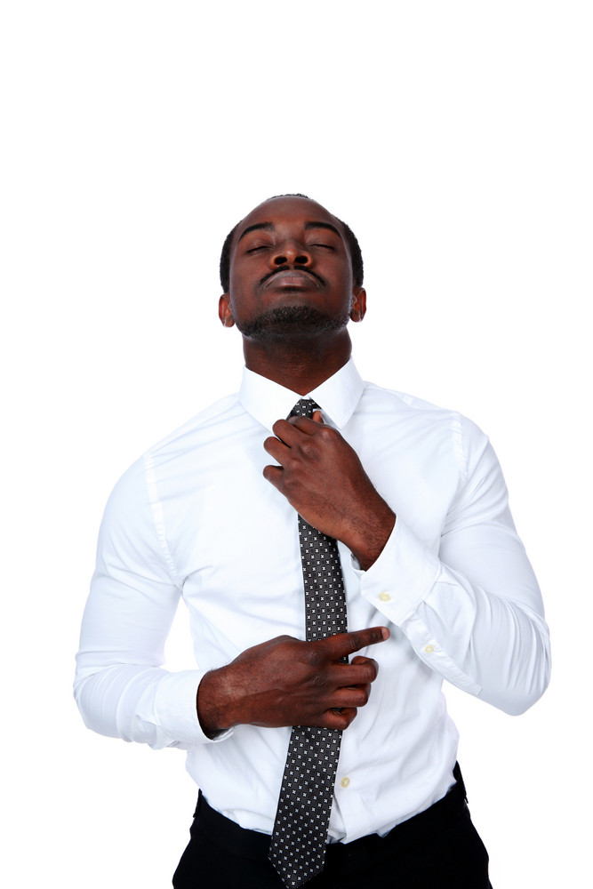 African man adjusting his necktie over white background