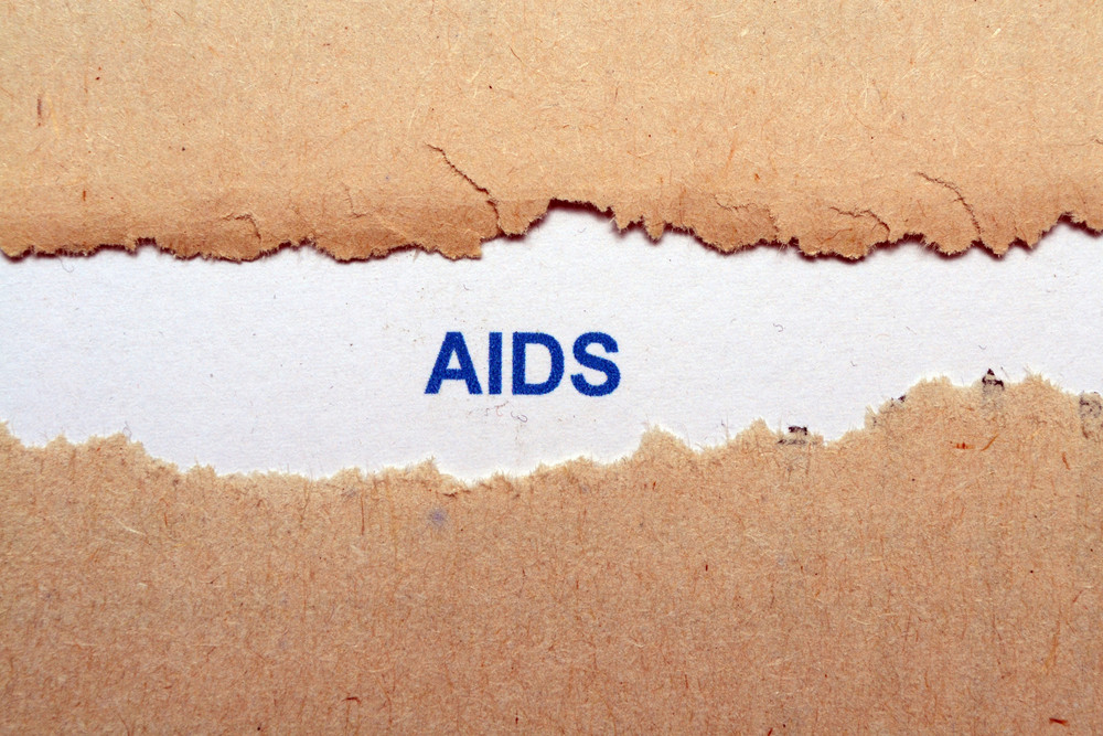Aids Text On Torn Paper