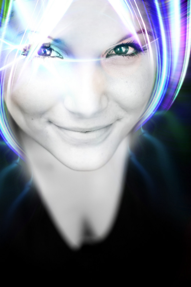 An abstract woman with glowing plasma like hair.