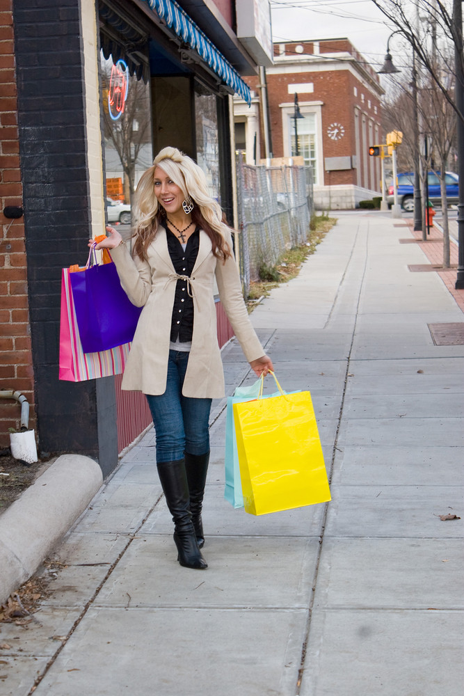 An attractive girl out shopping in the city.