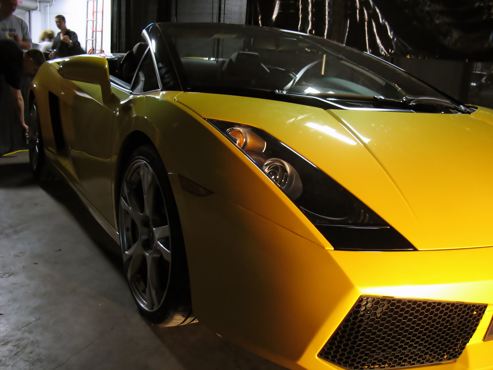 An exotic yellow sports car.