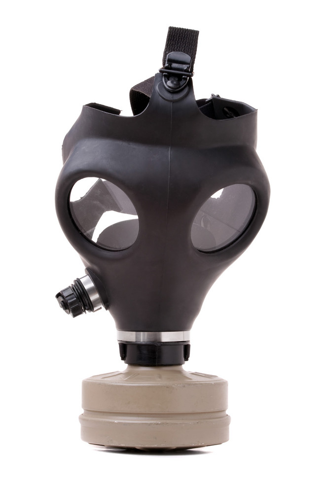 An old worn gas mask with black rubber isolated on white.