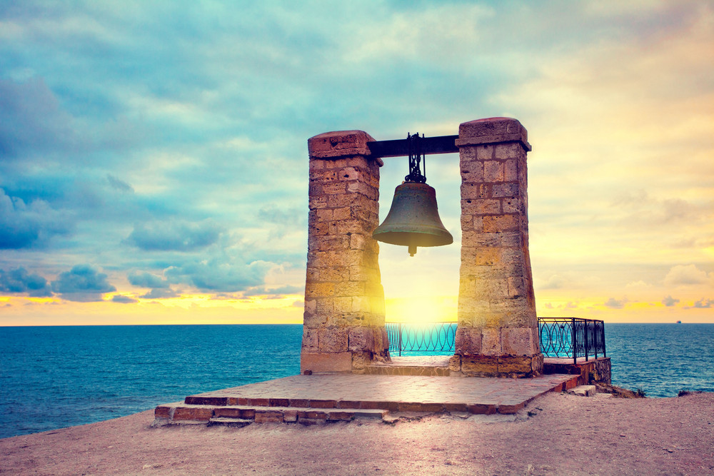 Ancient bell at sunset. In ancient city Chersonesos