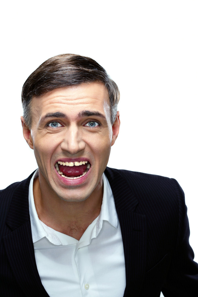 Angry businessman shouting isolated on a white background