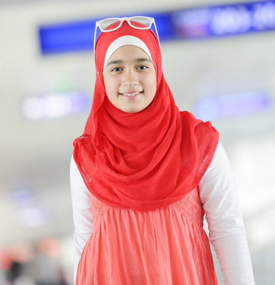 Arabic Middle eastern teenage girl traveling, airport transit