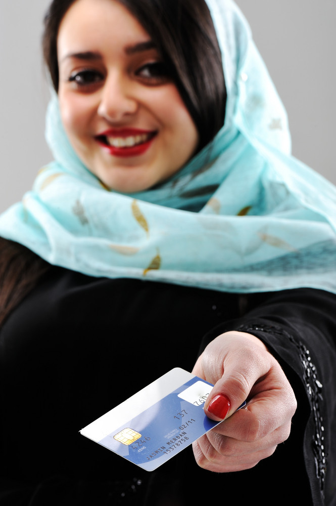 Arabic woman with shopping credit card