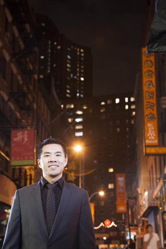 Asian man in chinatown at night
