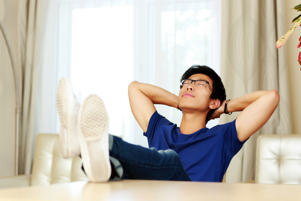 Asian man relaxing at home