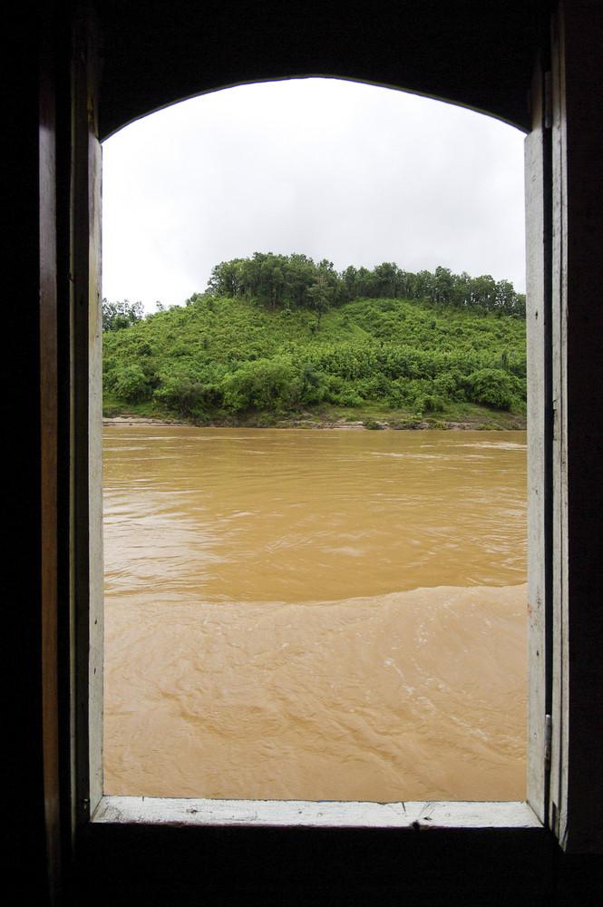 Asian river through boat window