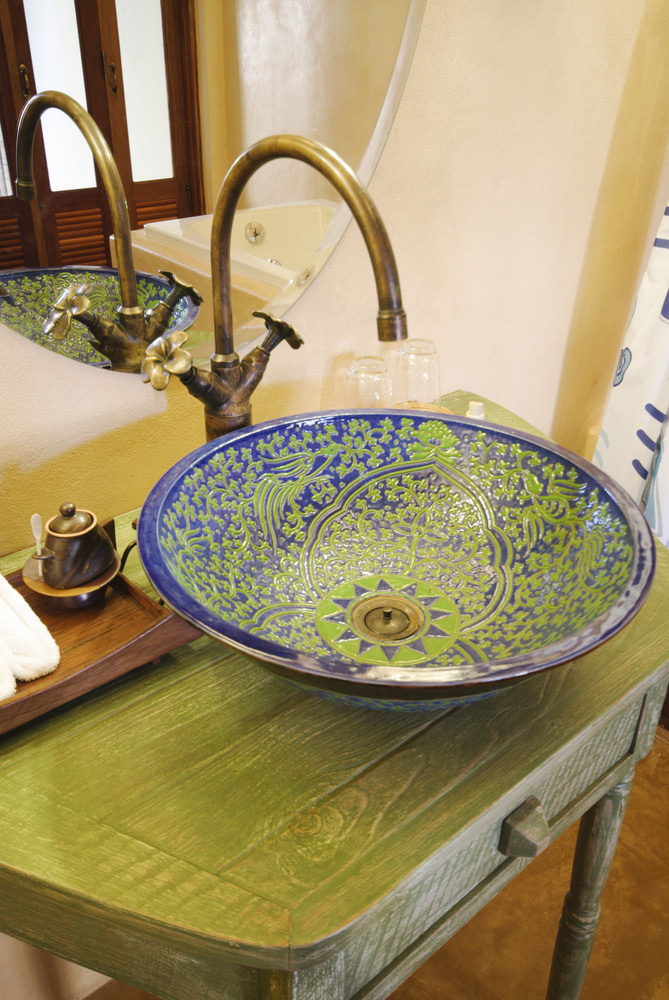 Asian vintage washbasin and chrome tap