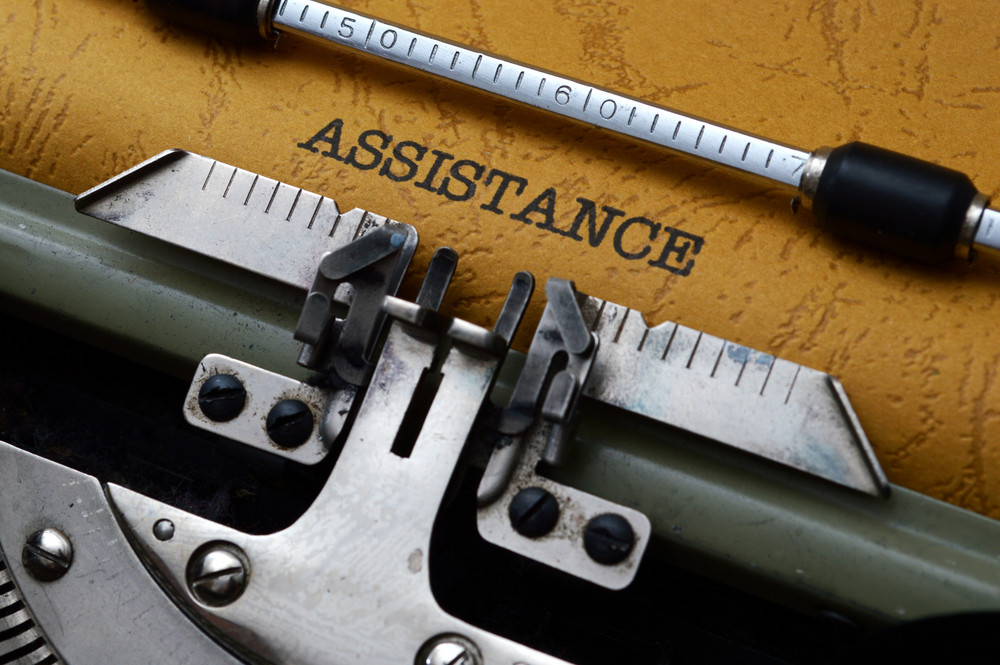 Assistance Text On Typewriter