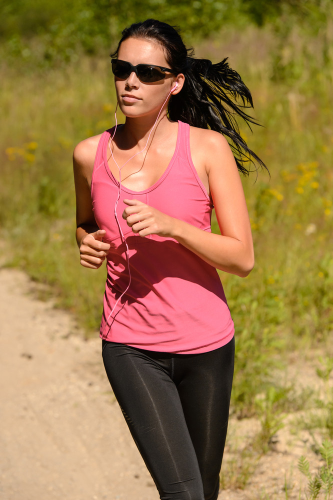 Athlete woman running training on sunny day with sunglasses