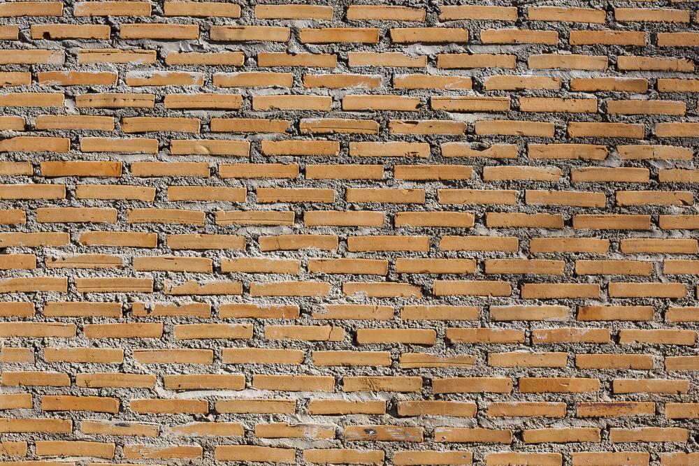 Background of orange brick wall texture