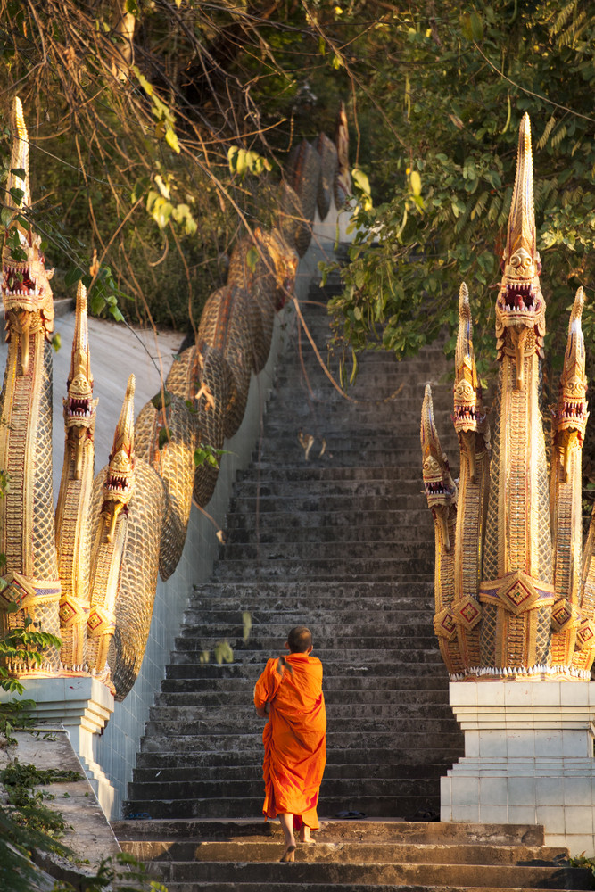 Barefooted buddhist monks in Chiang Mai Thailand