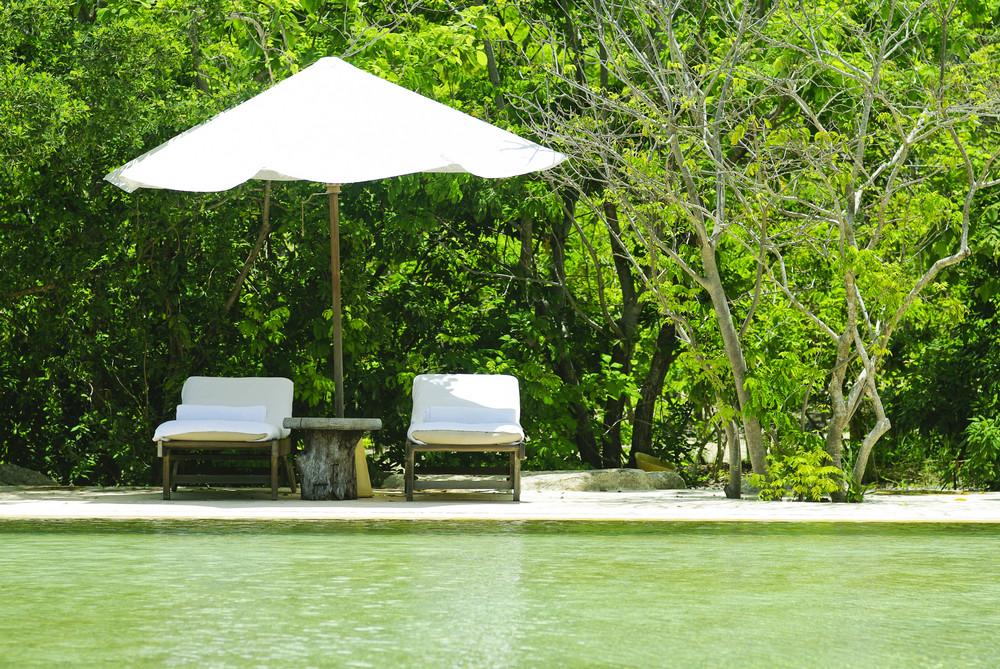 beach chair and White Umbrella