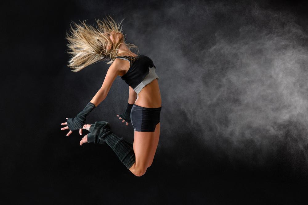 Beautiful dancer exercise jump in studio practice dancing rehearsal performance