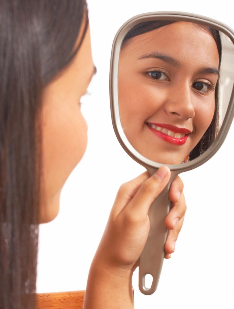 Beautiful Girl Looking In The Mirror