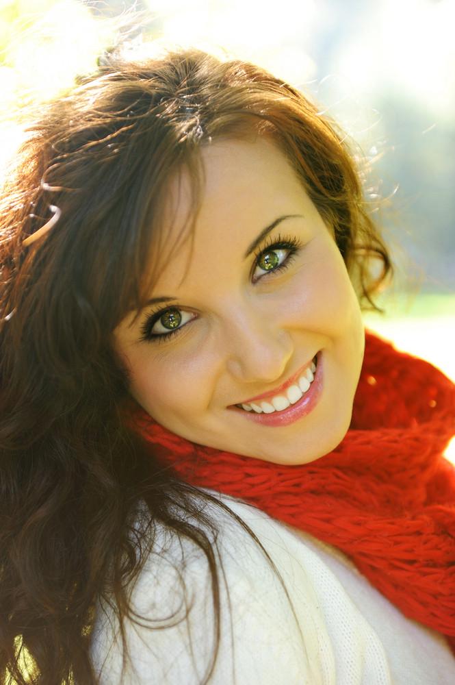 Beautiful happy girl in nature, portrait, long brown hair