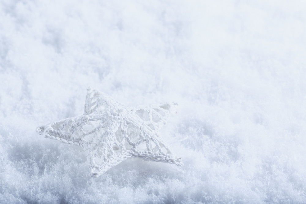 Beautiful magical vintage white star on a white snow background. Winter and Christmas concept.