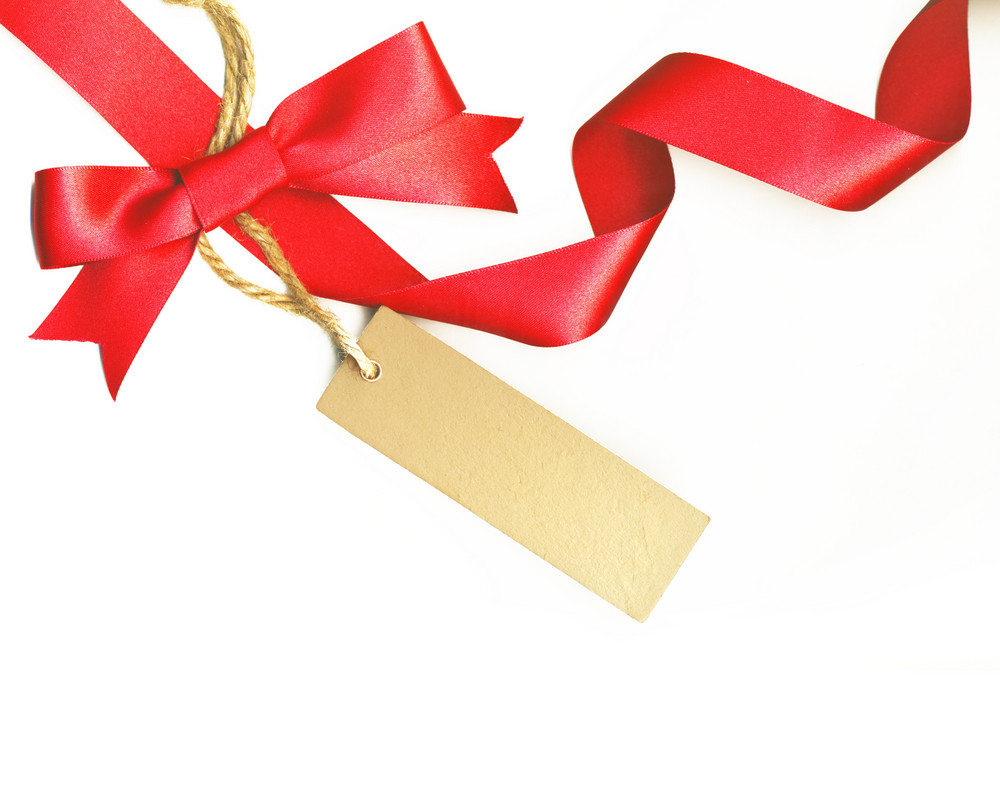 Beautiful Ribbon With Red Bow And A Label Isolated On White Background
