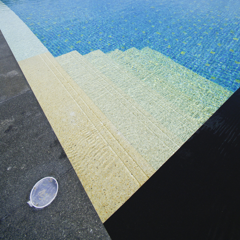 Beautiful swimming pool and deck composition.