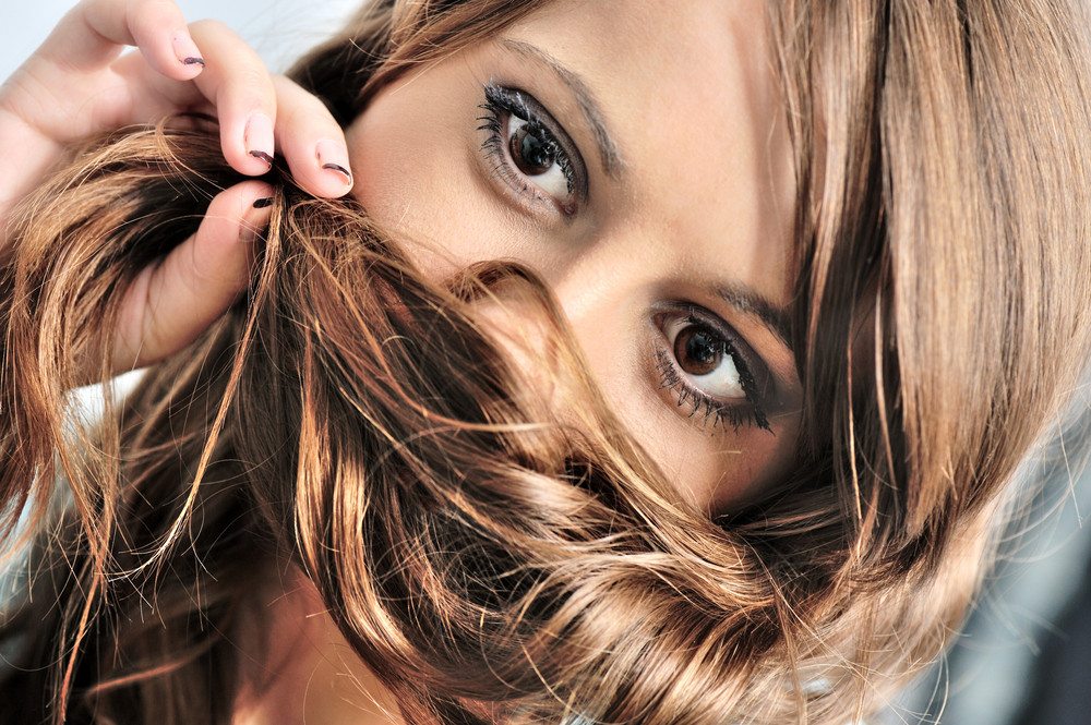 Beautiful Woman With Hair Infront Of Face Royalty Free Stock Image
