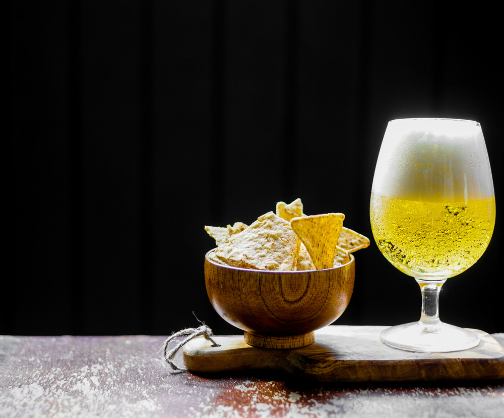 Beer And Chips On Wooden Background
