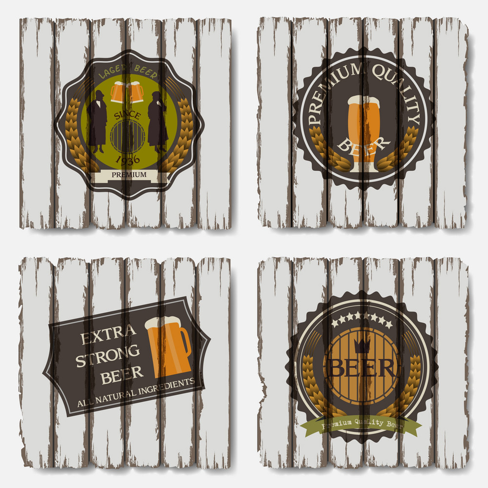 Beer Badges And Labels On Old Wood Background