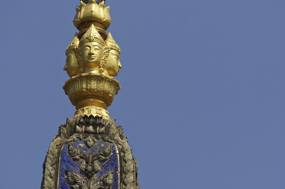 Bhuddistic sculpture on blue sky