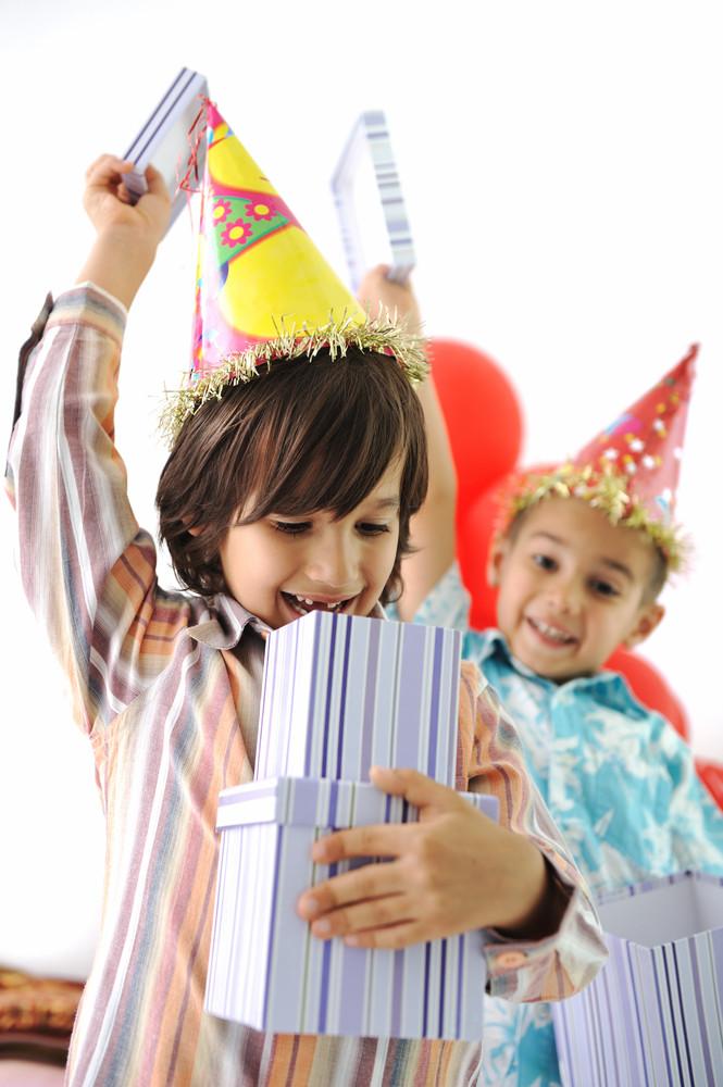Birthday party, happy children celebrating, balloons and presents around