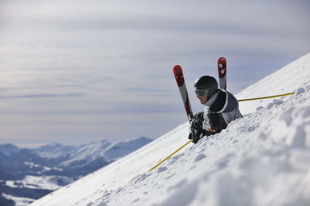 Young skier relaxing at beautiful sunny winter day