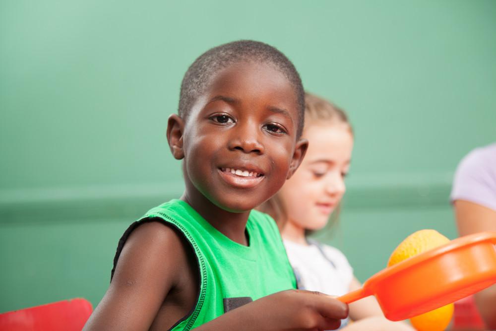 Black boy playing in Kindergarten