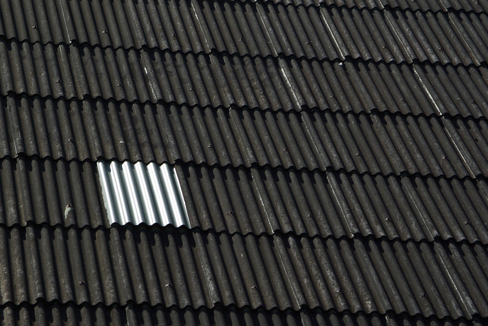 Black color roof of house