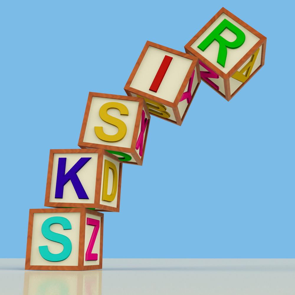 Blocks Spelling Risks Falling Over As Symbol For Danger Or Chance