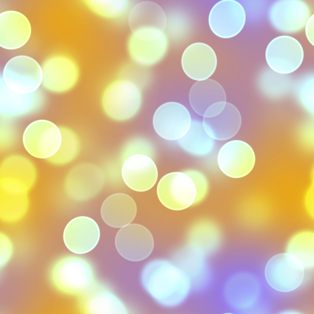 Blurred golden circles that look like out of focus bokeh.