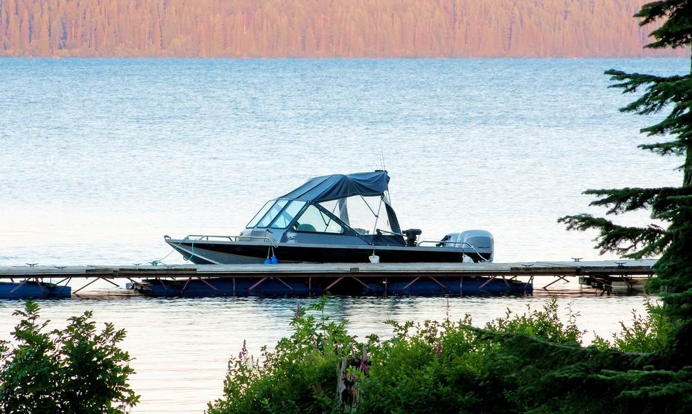 Boat Docked At Lake