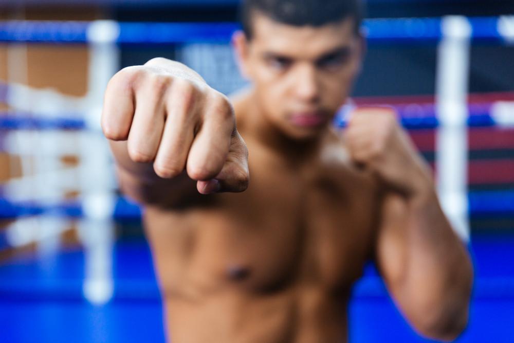 Boxer hitting at camera. Focus on fist