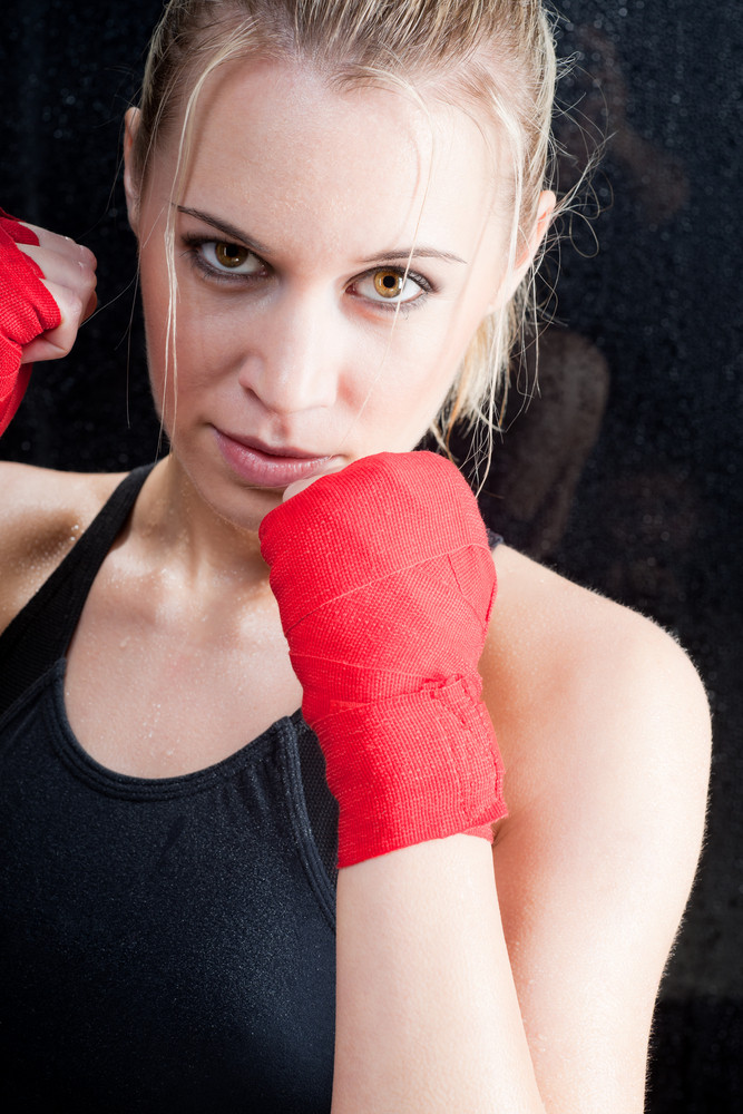 Boxing training blond woman sparring and sweating