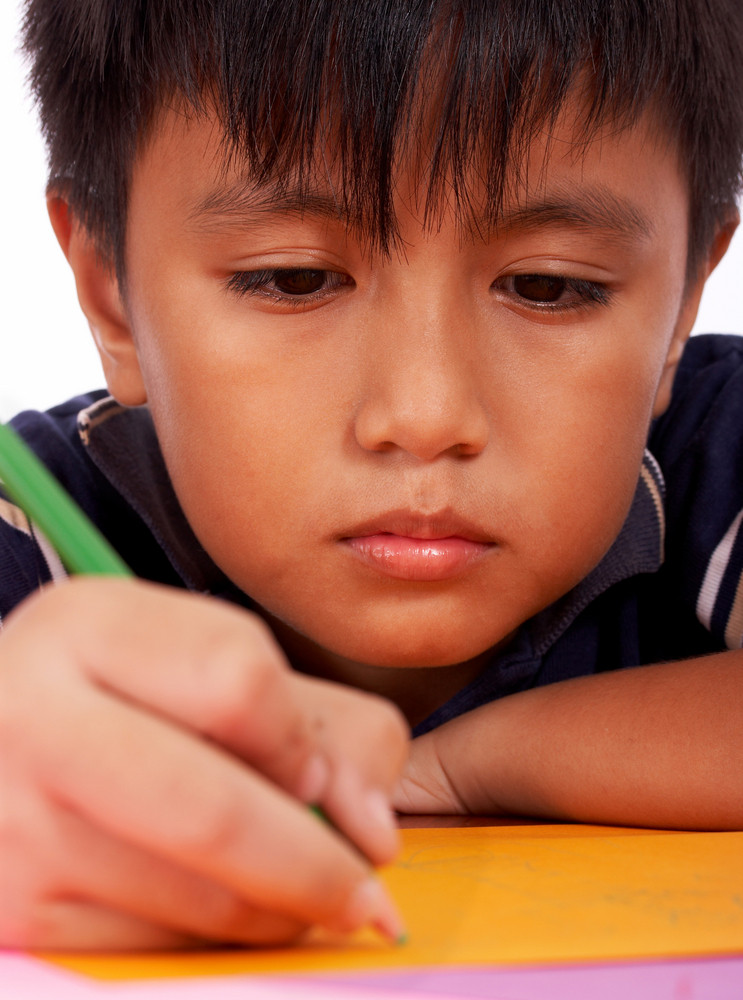 Boy Concentrating On His Drawing